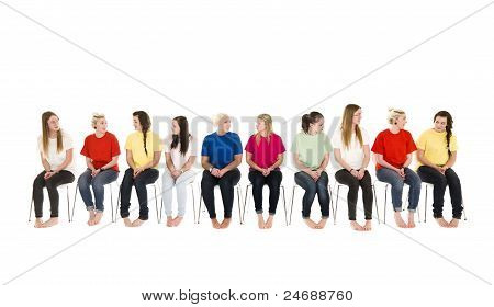 Group Of Women On Chairs In A Line