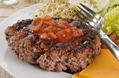 pic of ground-beef  - A lean broiled ground beef patty with cheese and greens - JPG