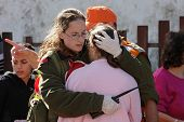 ASHKELON - JANUARY 10: Israeli soldier from rescue team hugs woman who witnessed a missile launched