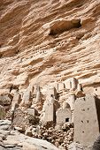 stock photo of dogon  - Dogon village in Mali, below the Bandiagara Escarpment (west Africa). The Dogon are best known for their mythology their mask dances wooden sculpture and their architecture. - JPG