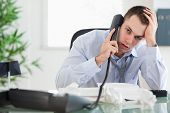 image of fail job  - Troubled young businessman on the phone - JPG