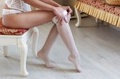 Charming And Seductive Woman In White Nylon Stockings. Beautiful And Sexy Female Legs And Body. poster