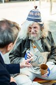 Hippy Man. Unemployed Elderly Hippy Man Feeling Lost And Unhappy While Begging For Help poster