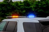 Blue And Red Flashing Sirens Of Police Car During The Cruiser Flashing Red And Blue Emergency Lights poster