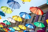 Colorful Umbrellas Background. poster
