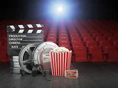 Cinema, movie or home video concept background. Film reels, clapper board  and pop corn in the theat poster