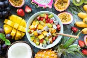 Tropical Fruit Salad With Mango And Pitaya In Bowl. Healthy Salad. Mango, Coconut, Pineapple, Pitaya poster