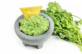 A Photo Of Guacamole Sauce In A Molcajete, Traditional Mexican Mortar, On A White Background, With A poster