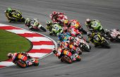 SEPANG, MALAYSIA - OCTOBER 23: MotoGP riders take turn 1 on race day of the Malaysian Motorcycle GP