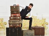 Man, Butler With Beard And Mustache Delivers Luggage, Luxury White Interior Background. Macho Elegan poster