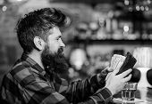 Wasting Money On Alcohol Concept. Guy Spend Leisure In Bar, Defocused Background. Hipster Holds Wall poster