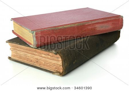 Two vintage books stacked together isolated over white background