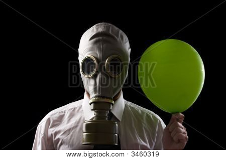 Businessman With Gas Mask And Green Baloon