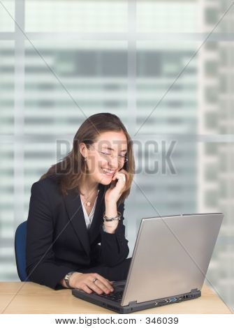 Business Woman On Laptop In Her Office