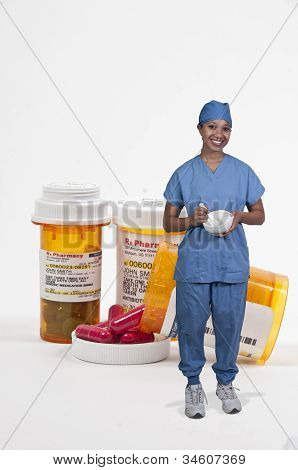 Doctor And Bottle Of Prescription Pills
