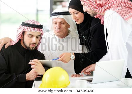 Portrait of araabic architect explaining his project