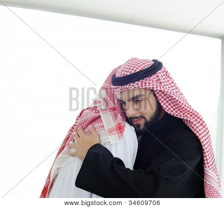 Arabic business people hugging each other