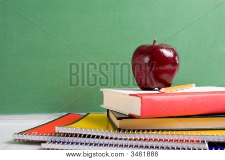 School Books And An Apple