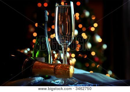 Glass And Bottles Of Champagne