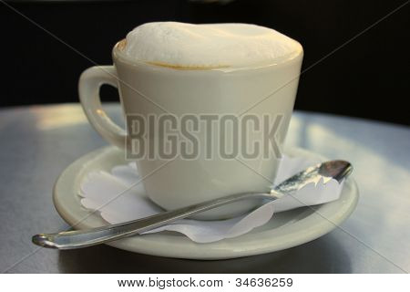 A hot steamy cup of cappuccino