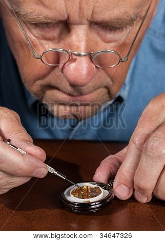 Senior Craftsman Repairing Pocket Watch