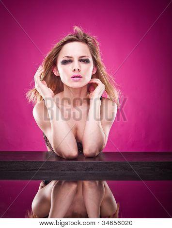 Pretty Woman In A Bra Reflected In Mirror