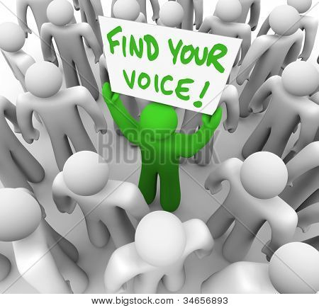 The words Find Your Voice on a banner held by a green man in a crowd of grey people, having just gained the confidence to speak what is on his mind and share his opinion and feedback