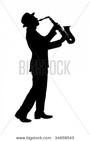 A silhouette of a full length portrait of a man in a suit playing on saxophone isolated against background