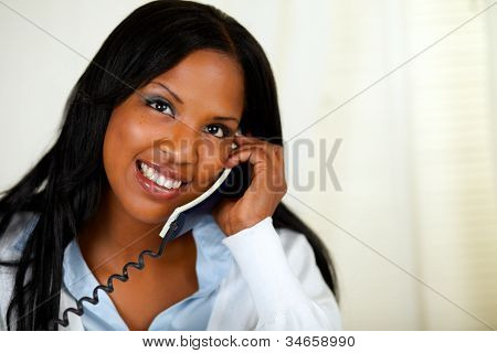 Happy Young Female Speaking On Phone