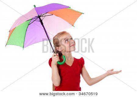 Little girl under umbrella looking up