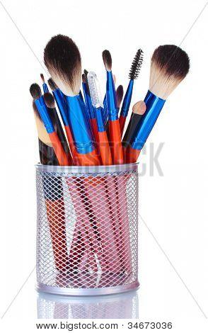 make-up brushes in holder isolated on white