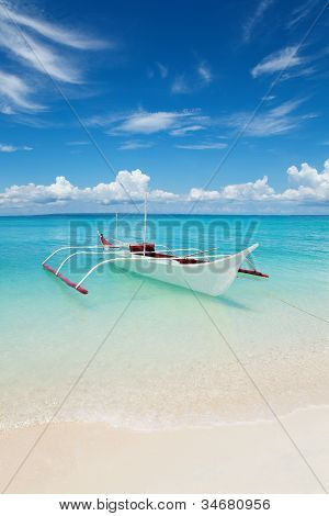White Boat On A Tropical Beach