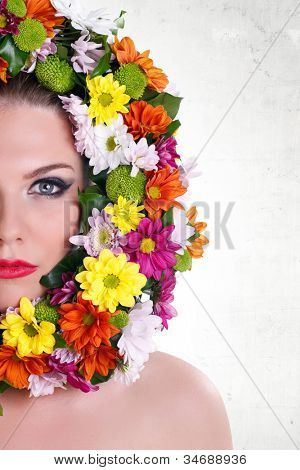 Close-up make-up woman�s face with border of flowers, isolated on white background