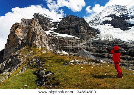 Alpinist contemplating Eiger Peak, Switzerland