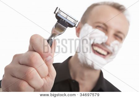 Happy Handsome Man Showing His Razor Before Shaving