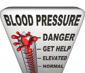 picture of pressure point  - Blood Pressure words on a thermometer measuring your hypertension - JPG