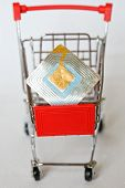 The Metal Trolley From The Supermarket, In Which Lies The Rfid Tag. Goods Security And Alarm. Vertic poster