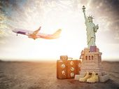 Flight to New York, USA.Vintage suiitcase with symbols of United States Statue of Liberty Travel and poster