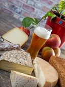 Cheeses And Tomme De Savoie With A Glass Of Beer, French Cheese Savoy, French Alps France. poster