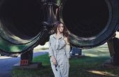 Fashion In Military. Woman Model Wearing Military Uniform With Aircraft Background poster
