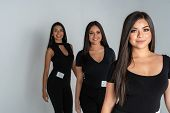 3 female models at an audition or casting for a runway model poster