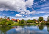Town park and Rothenburg pond at Dinkelsbuhl Old Town, Central Franconia, Bavaria, Germany, a popula poster