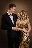 Elegant Couple, Beautiful Fashion Woman In Gold Dress, Elegant Man In Tuxedo Suit, Face To Face Port poster