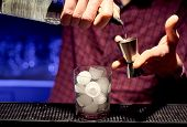 Bartender Is Preparing A Cocktail At A Nightclub. poster
