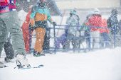 Peoples With Ski Gear Standing On The Lift Line At A Ski Resort In Winter Blizzard. poster