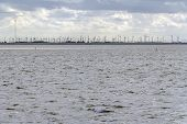 Coastal Scenery Including A Distant Wind Farm Near Neuharlingersiel In Eastern Frisia, Germany poster