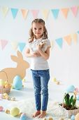 The Girl With The Rabbit. Happy Little Girl Holding Cute Fluffy Bunny. Friendship With Easter Bunny. poster