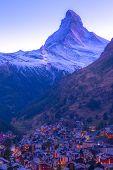 Zermatt, Switzerland Town Night Aerial View And Matterhorn Snow Peak In Famous Swiss Ski Resort, Swi poster