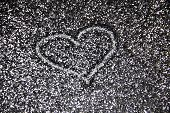 Drawing A Heart On The Silver Sand Glitter. A Heart Against A Silver Texture On The Glitter Backgrou poster
