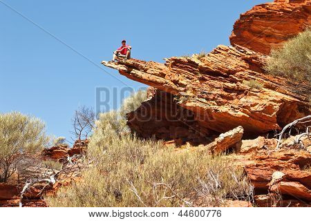 Man Sitting On The Rock Edge